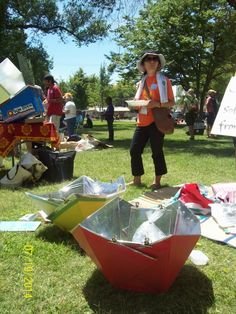"""Fumi Sakurai with her """"Sun Peace"""" panel cookers from Japan. Disseminated in Madagascar.  Sacramento, CA SCI Festival, 19 July 2014"""