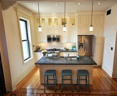 I love the soapstone counters and the white cabinetry. Also, the floors are beautiful. Why can't Indianapolis have old limestone row houses?