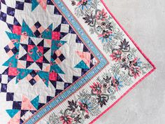 A mitered border made with eye-catching border prints can be a beautiful (and easy!) way to kick your top up a notch. Learn how with our tutorial!