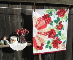 ::This sweet vintage tea towel was handmade with lots of love by me, using a vintage red rose tablecloth, with modern and vintage fabric, a vintage doily, and vintage lace in the back to hang your sweet tea towel up, if you so chose.    ::I have crocheted a most lovely pretty red edging using %10...