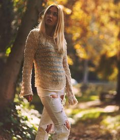 See through knit sweater Striped with textured yarn Embroidered with flocking tape flakes Loose and stretchable Long sleeves with flared cuffs 65% cotton, 35% acrylic