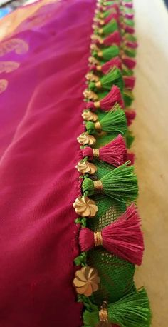 Latest Simple saree tassels collections_ Saree Kuchu with Crystals and Beads Designs! Saree Kuchu New Designs, Saree Jacket Designs, Saree Tassels Designs, Pattu Saree Blouse Designs, Blouse Designs Silk, Blouse Designs Catalogue, Churidar Designs, Silk Thread Bangles Design, Saree Jackets