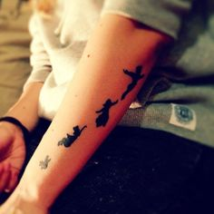 peter pan tattoo. Love the placement
