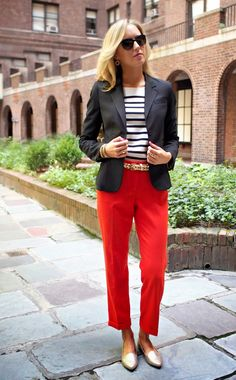 red pants with striped top and blazer with gold belt