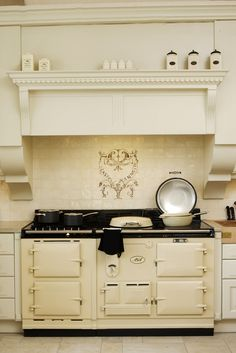 Nothing better than an AGA stove in a kitchen. I stayed at sporting estate in Scotland that had a large one like this and it heated the entire manor.  www.agastoves.co.za