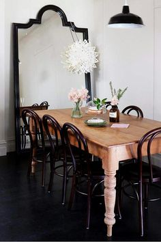 I love the big floor mirror in the dining room placed at head of the table to make the room look bigger & its just plain pretty!