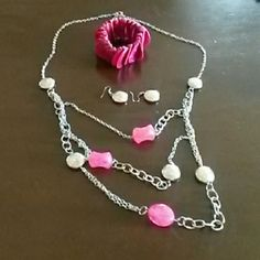 Necklace, bracelet, & earrings Long silver necklace with pink stones & silver matching dangle earrings. Bracelet is pink and stretchy. Very cute ensemble! Jewelry