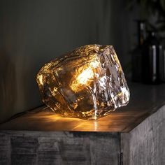 This Rock table lamp is a real eye-catcher! The table lamp is in the shape of a rock and is made out of mouth blown glass. Retro Lampe, Drop Lights, Natural Interior, Led Lampe, Cafe Design, Glass Table, Fairy Lights, Decoration, Glass Art