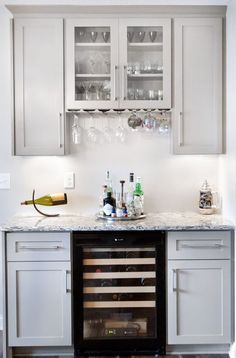 kitchen living rooms remodeling A small white home bar between the kitchen and living room with light gray cabinets and beautiful white granite countertops. - Check out 77 custom home bar design ideas. All styles, sizes and materials. These are amazing. Kitchen Bar Design, Living Room Kitchen, Home Bar Design, Home Bar Designs, Bars For Home, Room Remodeling, Light Gray Cabinets, Living Room Bar, White Granite Countertops