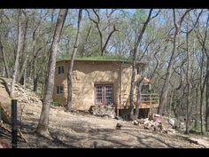"straw bale ""cabin"" off grid, self-build for family of 6!  (I would have put the tub in an insulated pocket in the floor w/ lift-off flooring) ""it cost about 10k minus the porch - took 4 months to make it livable and a bit longer to make it beautiful"""
