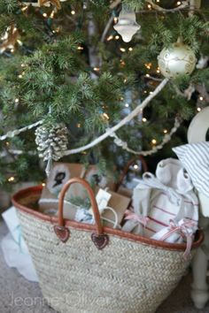 2013 Holiday Housewalk {Welcome To Our Home} | Jeanne Oliver  Woven basket with gifts wrapped in vintage linens