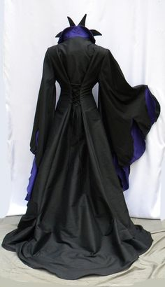 Wicked drama is combined with luxury in this Malificent character cosplay gown. A most elegant diva villain dressing experience full flared and lengthy in black, with vibrant dark purple and bright fuchsia accent details. Perky lapel collar with inner spikes, maximum fullness and flame shape in sleeves, lace up back. Maleficent Halloween Costume, Maleficent Cosplay, Halloween Costumes, Halloween 2019, Halloween Party, Run Disney Costumes, Running Costumes, Costumes For Women, Full Length Gowns
