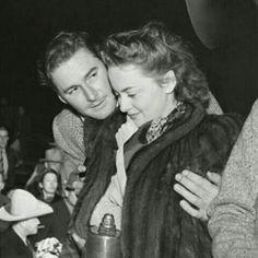 Errol Flynn & Olivia de Havilland. Look at that secret little happy smile she has