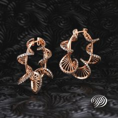 I dunno if I would wear these, they look awesome though. Rose Gold Diamond Ribbon Earrings