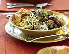 "Steamed Clams with Pasta - simple, no butter, just evoo, add white wine, we put that ""stuff"" on everything!"