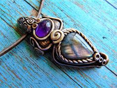 Pink purple play of color Labradorite pendant necklace combined with natural purple amethyst gemstone cabochon. This healing crystal pendant is set in durable polymer clay and comes with adjustable le