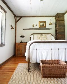 Rustic and vintage bedroom in whites and wood. Love the ceiling and bed