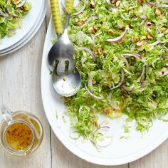 Shaved Brussels Sprouts Salad with Lemon-Chile Vinaigrette & Toasted Hazelnuts Recipe - EatingWell Easy Salad Recipes, Easy Salads, Side Dish Recipes, Vegetable Recipes, Healthy Recipes, Side Dishes, Fruit Salads, Summer Salads, Shaved Brussel Sprouts