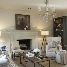 Dana Wolter Interiors - living rooms - charcoal, gray, bookshelf, white, tufted, chair, round, white, tufted, storage, ottoman, industrial, coffee table, white, brick, fireplace, surround, art, tripod floor lamps, wood tripod floor lamps, Visual Comforts Tripod Floor Lamp - Tudor Brown,