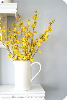 Used flowers very similar in a mike glass vase for our Spring Mantel//Spring flowers in a white pitcher.....nice....
