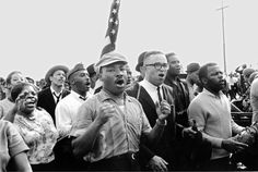Martin Luther King Jr. and thousands of Voting Rights activists (including Georgia Congressman John Lewis, right) marches toward the Edmund Pettus Bridge.