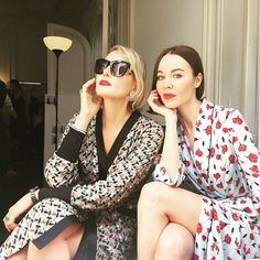 Renata Litvinova and Ulyana Sergeenko in Paris, wearing Ulyana Sergeenko dresses and sunglasses