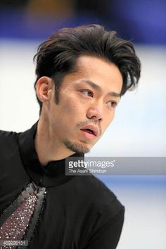 Daisuke Takahashi reacts after competing in the Men's Short Program during the day one of the 82nd All Japan Figure Skating Championships at Saitama...