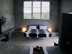 bedrooms-gray-beds-bedspreads-concrete-floors-hotels-shutters-side-tables-table-lamps