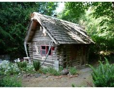 Rustic island log cabin in British Columbia, built in 1986, 241 sq ft, yours for $89,000 Canadian dollars.