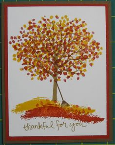 handmade Autumn card from Stampin' on the Prairie ... Sheltering Tree in glorious Fall colors with rake and some stamped leaves to ground it .. lovely ... Stampin' Up!