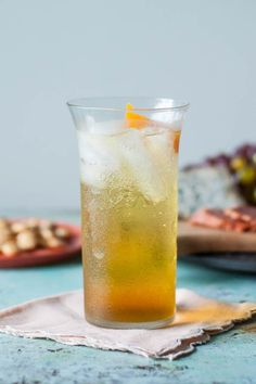 The Expat 1 1/2 ounces Gran Classico 1 ounce Carpano Dry Vermouth seltzer garnish: orange peel