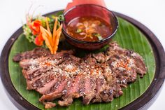 "Jim Thompson Restaurant and Wine Bar ""Seau Rong Hai - The Tiger weeps) Thai style grilled rip-eye steak served with ground roasted rice, shallots, chili and tamarind sauce #thaifood #thairestaurant #jimthompson #bangkok #thailand"