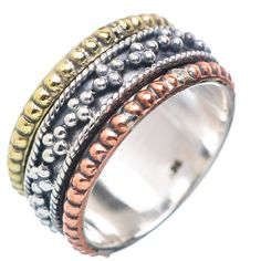"""Three tone Sterling Silver Spinner ring. DETAILS: * Size 7 available * 5.3 g total weight * SOLID .925 Sterling Silver * Stamped .925 * Measures approximately 3/8"""" wide Spinner Rings are also called T"""