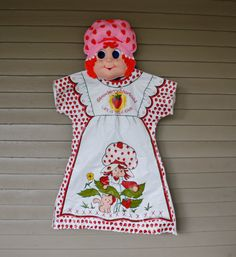 Whether Trick-or-Treating or just collecting cool stuff, this Strawberry Shortcake costume is sweet! Small tears to the mask near the ears, but still in