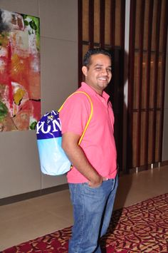 Shehan Wanigasekera from Cinnamon Grand Colombo's Sales Department modelling a B2b (Banners to Bag) bag.