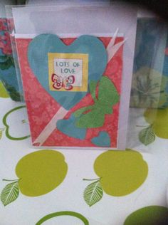 With love card, bright and colourful with die cut detail.