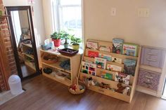 After a month of designing, purchasing and experimenting, I'm finally happy with the Montessori design of our new home. When we first moved in, Mark and I agreed that the thick, dark-green carpeting i Playroom Montessori, Montessori Baby, Montessori Homeschool, Montessori Activities, Homeschooling, Finally Happy, 2 Kind, Home Daycare, Play Spaces
