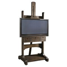 Easel-inspired media console with 3 drawers.     Product: Media consoleConstruction Material: Oak veneer and solid ha...