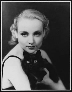 Actress Carole Lombard with cat