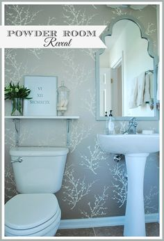 Update a boring, builder powder room with a few simple changes. Hang temporary wallpaper on one wall, add a mirror (spray-painted to match), a simple shelf and some decorative accessories. Big impact for a small budget. http://www.rustoleum.com/product-catalog/consumer-brands/universal/universal-gloss-spray-paint/
