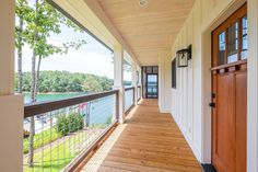 Exclusive Show-Stopping Vacation Home Plan with 3-Sided Wraparound Porch - 18302BE | Architectural Designs - House Plans Barn Homes Floor Plans, Lake House Plans, Dream House Plans, Dream Houses, Carriage House Plans, Modern Lake House, Porch Plans, Open Space Living, Home Fireplace