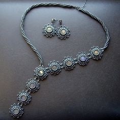 This necklace is made in the same way as this one but is much more conservative. The flowers are formed of black freshwater pearls and seed beads.