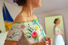 This bride created the top portion of her dress using vintage embroidered table cloths! It looks stunning.