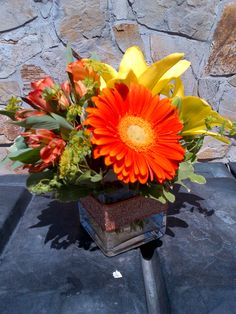 Cube Arrangements, Gerberas, Yellow Lily, Alstroemerias complimented with ribbon