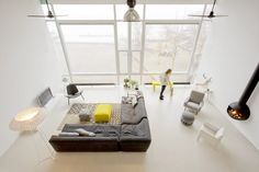 Loft! Marc Koehler Architects transformed an old harbor-cantina on KNSM eiland in Amsterdam into large apartments.