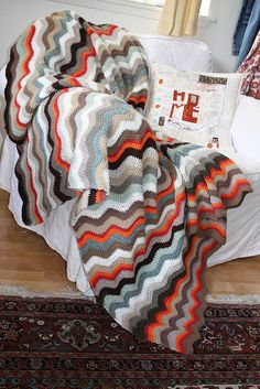 Same ripple/chevron pattern in tamer colours. Ripple Afghan by Umzavi, via Flickr