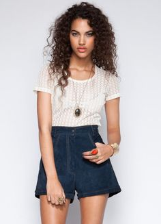 """Lovely lace at it's best. Stones Mikey Lace Tee is perfect to throw over a bandeau for a effortlessly chic look.  100% Polyester  20"""" length  Model is wearing size S"""