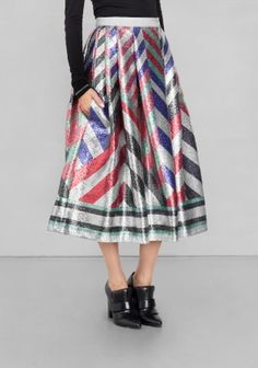 SADIE WILLIAMS A shimmering A-line skirt featuring an allover geometric print in bright colours and a flattering midi length.