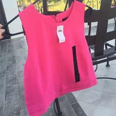NWT Banana Republic blouse Hot pink, super cute looks great w high wasted jeans and leather jacket for winter! Black mark in the mirror photo is not on the blouse, it's on the mirror! Banana Republic Tops Blouses