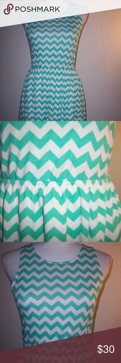 Green White Sleeveless Chevron Dress Sz Small Women's sleeveless lined dress  Size small Green and white chevron print on the shell with solid white lining  Metal button and loop closure above cutout back - photo 6 Metal button in back  is a bit tarnished Polyester , rayon , spandex blended shell Lining is 100% polyester  Elasticized at the waist  Tag states to hand wash in cold water or dry clean for care  Measures about 33 inches long from top of shoulders to hemline  Measures about 18…